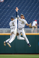 Michigan Wolverines shortstop Jack Blomgren (2) and outfielder Jordan Brewer (22) celebrate defeating the Texas Tech Red Raiders in the NCAA College World Series on June 21, 2019 at TD Ameritrade Park in Omaha, Nebraska. Michigan defeated Texas Tech 15-3 and will play in the CWS Finals. (Andrew Woolley/Four Seam Images)
