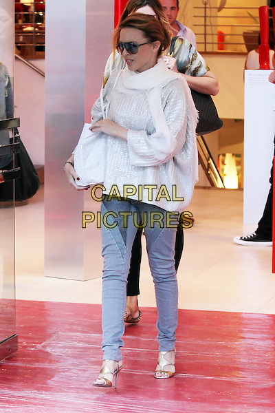 Kylie Minogue.visits the Conran Shop in Chelsea, London, England..19th September 2012.full length white scarf silver top jeans denim bag purse sunglasses shades silver gold sandals .CAP/HIL.©John Hillcoat/Capital Pictures.