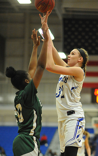 Lauren Romito #32 of Hauppauge, right, shoots a contested jumper during the Class A Long Island Championship against Elmont at Suffolk County Community College Grant Campus in Brentwood on Thursday, March 8, 2018. Elmont won by a score of 56-30.