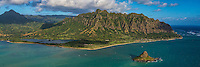 A panoramic view of Windward O'ahu, including Moli'i and 'Apua Fishponds on the left, the Ko'olau Mountains, and Chinaman's Hat in the foreground.