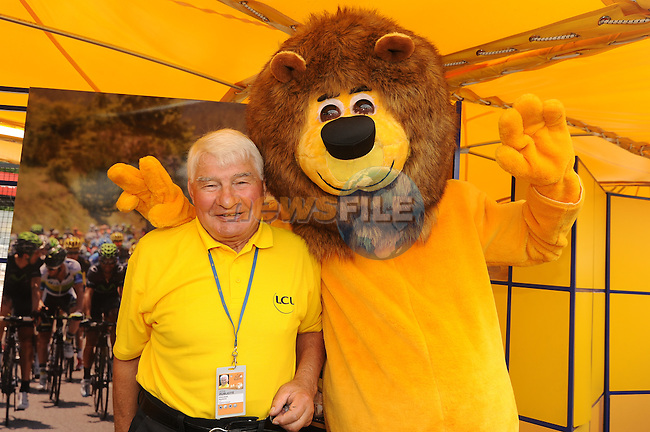 Raymond Poulidor with the LCL mascot in the Tour Village before the start of Stage 8 of the 2014 Tour de France running 161km from Tomblaine to Gerardmer La Mauselaine. 12th July 2014.<br /> Photo ASO/B.Bade/www.newsfile.ie
