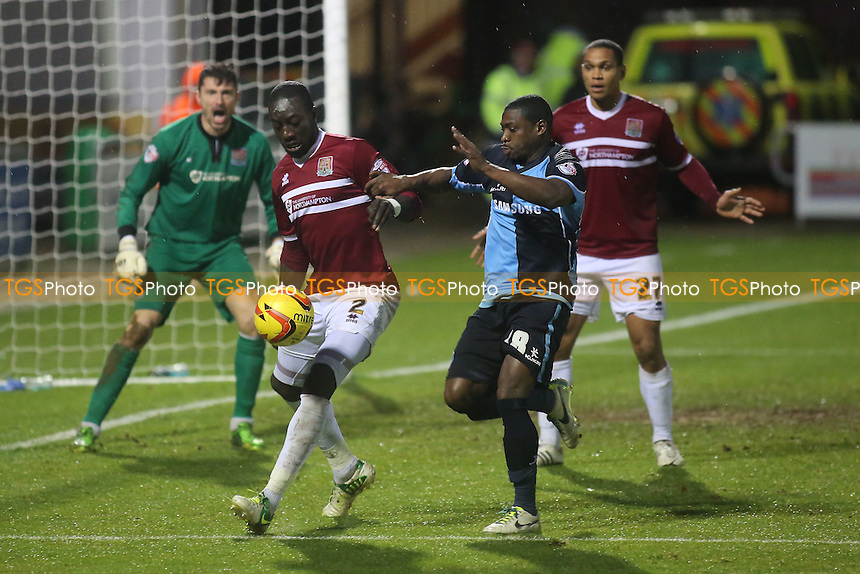 Kevin Amankwaah of Northampton & Wycombe's Joe Kuffour - Northampton Town vs Wycombe Wanderers - Sky Bet League Two Football at the Sixfields Stadium, Northampton - 21/12/13 - MANDATORY CREDIT: Paul Dennis/TGSPHOTO - Self billing applies where appropriate - 0845 094 6026 - contact@tgsphoto.co.uk - NO UNPAID USE