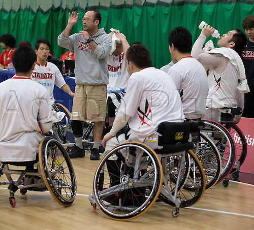 03.07.2016. Leicester Sports Arena, Leicester, England. Continental Clash Wheelchair Basketball, USA versus Japan.  Coach Shimpei Oikawa gives instruction to Team Japan during the time out