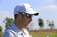 Ross Fisher (ENG) on the range during Tuesday's Pro-Am Day of the 2014 BMW Masters held at Lake Malaren, Shanghai, China 28th October 2014.<br /> Picture: Eoin Clarke www.golffile.ie