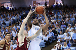 18 January 2014: North Carolina's Leslie McDonald (right) shoots over Boston College's Joe Rahon (25). The University of North Carolina Tar Heels played the Boston College Eagles in an NCAA Division I Men's basketball game at the Dean E. Smith Center in Chapel Hill, North Carolina. UNC won the game 82-71.
