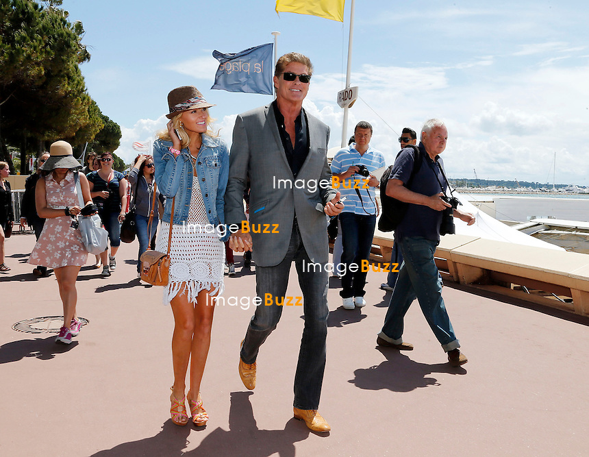 David Hasselhoff and his girlfriend Hayley Roberts seem to be having a blast in Cannes. .The couple, who are in France for the 66th Cannes Film Festival, soaked up the sunshine on Friday morning. .Strolling along the Promenade de la Croisette, the glamorous pair stopped for lunch at the LA Mandala restaurant.  Cannes, May 17, 2013.