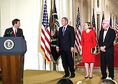 Washington, DC - September 29, 2005 -- Chief Justice of the United States John Glover Roberts, Jr. makes remarks after taking his oath of office in the East Room of the White House in Washington, D.C. on September 29, 2005.  From left to right: Chief Justice Roberts, United States President George W. Bush, Jane Sullivan Roberts, Associate Justice John Paul Stevens..Credit: Ron Sachs / CNP