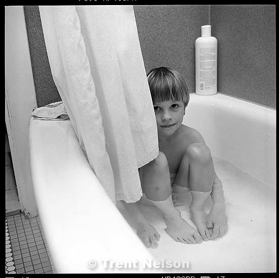 Nathaniel Nelson in bathtub<br />