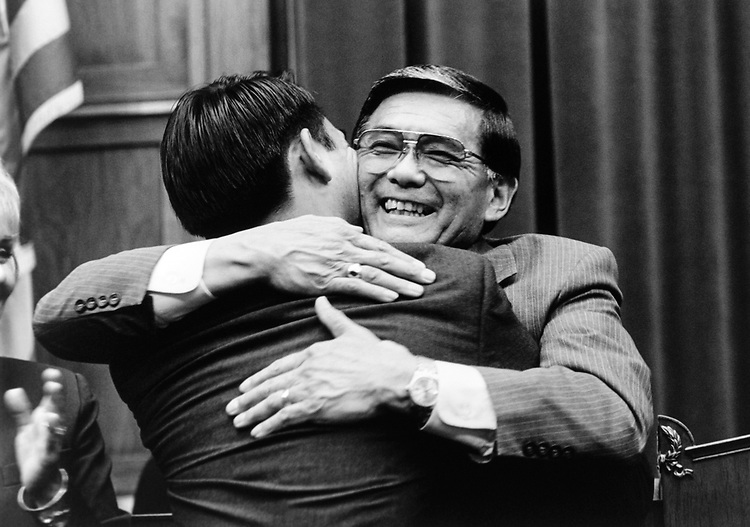 Stuart Mineta gets a hug from dad, Rep. Norman Mineta, D-Calif. Unveiling of the portrait ceremony for Rep. Norman Mineta, who is resigning in Oct., 1995. (Photo by Maureen Keating/CQ Roll Call)