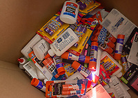 NWA Democrat-Gazette/BEN GOFF @NWABENGOFF<br /> A box begins to fill with supplies Friday, Aug. 3, 2018, at the United Way of Northwest Arkansas Fill the Bus drop-off location at the Walmart Supercenter on Pleasant Crossing Boulevard in Rogers. Volunteers are manning busses at ten Walmart Supercenter locations in Northwest Arkansas and Pineville, Mo. from 9:00 a.m. to 3:30 p.m. Friday and Saturday to sort donated school supplies. The donations will go directly to the district the Walmart location is in. Over the past ten years, the annual drive has helped more than 35,000 students in 12 school districts get the supplies they need to start the school year.