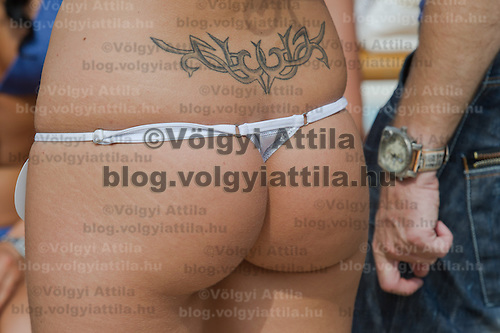 Bikini of participants is seen from behind during the Miss Bikini Hungary beauty contest held in Budapest, Hungary on August 06, 2011. ATTILA VOLGYI