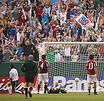 26 May 2006: Brian Ching (USA) (l) celebrates after his first half goal had been Venezuela goalkeeper Javier Toyo (center, on ground) and Oswaldo Vizcarrondo (VEN) (4) and Leonel Vielma (VEN) (13) giving the U.S. a 1-0 lead. The United States Men's National Team defeated their counterparts from Venezuela 2-0 at Cleveland Browns Stadium in Cleveland, Ohio in a men's international friendly soccer game.