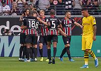 celebrate the goal, Torjubel zum 1:1 Ausgleich  Andre Silva (Eintracht Frankfurt) mit Goncalo Paciencia (Eintracht Frankfurt), Almamy Touré (Eintracht Frankfurt), Martin Hinteregger (Eintracht Frankfurt), Gelson Fernandes (Eintracht Frankfurt), Frust bei Jadon Sancho (Borussia Dortmund) - 22.09.2019: Eintracht Frankfurt vs. Borussia Dortmund, Commerzbank Arena, 5. Spieltag<br /> DISCLAIMER: DFL regulations prohibit any use of photographs as image sequences and/or quasi-video.