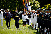 Washington, D.C. - May 7, 2007 -- Queen Elizabeth II of the United Kingdom reviews the troops with President George W. Bush as part of a South Lawn ceremony during her State Visit to the White House, Monday, in Washington, DC, May 7, 2007..Credit: Martin H. Simon - Pool via CNP