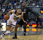 Nevada forward Caleb Martin (10) drives past San Diego State guard Adam Seiko (2) in the second half of an NCAA college basketball game in Reno, Nev., Saturday, Mar. 9, 2019. (AP Photo/Tom R. Smedes)