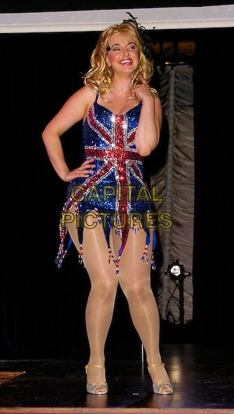 "REBECCA GETHINGS.""The Vegemite Tales"" photocall, The Venue Theatre, London, UK..August 1st, 2006.Ref: CAN.full length union jack sequins sequins sequined dress hand on hip blue red.www.capitalpictures.com.sales@capitalpictures.com.©Can Nguyen/Capital Pictures"