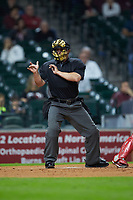 Home plate umpire John Schiller makes a strike call during the NCAA baseball game between the Mississippi State Bulldogs and the Louisiana Ragin' Cajuns in game three of the 2018 Shriners Hospitals for Children College Classic at Minute Maid Park on March 2, 2018 in Houston, Texas.  The Bulldogs defeated the Ragin' Cajuns 3-1.   (Brian Westerholt/Four Seam Images)