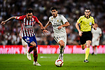 Marco Asensio of Real Madrid (R) in action against Jose Maria Gimenez of Atletico de Madrid (L) during their La Liga  2018-19 match between Real Madrid CF and Atletico de Madrid at Santiago Bernabeu on September 29 2018 in Madrid, Spain. Photo by Diego Souto / Power Sport Images