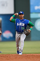 Second baseman Carlos Diaz (14) of the Lexington Legends throws out a runner during a game against the Greenville Drive on Sunday, September 2, 2018, at Fluor Field at the West End in Greenville, South Carolina. Greenville won, 7-4. (Tom Priddy/Four Seam Images)