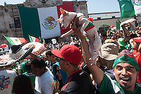 Los Angeles, CA -  Monday, June 23, 2014: A few thousand Mexico fans celebrate their victory over Croatia in a first round match at a public viewing at Plaza Mexico.