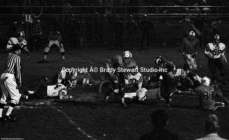 Bethel Park PA:  Offensive play with Mike Stewart 11 running the ball in the mud.  Others in the photo; Gary Biro 81, Bruce Evanovich 80.  The Bethel Park defense recovered 5 fumbles but the offense was not able to score against the Mt Lebanon Defense.  The field conditions were herendous, after every play you had to get the saw dust out of your eyes. After a highly disputed non-TD call  by Art Walker's brother in law, the undefeated Mt Lebanon Blue Devils  ended up winning the Western Conference.  The defensive unit was one of the best in Bethel Park history only allowing a little over 7 points a game.