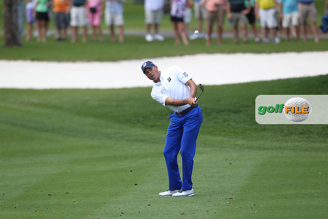 Matt Kuchar of USA chips onto the 1st green during the 3rd round of the Valspar Championship, Innisbrook Resort (Copperhead), Palm Harbor, Florida, USA<br /> Picture: Peter Mulhy / Golffile