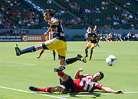 CARSON, CA - August 25, 2013: New York Red Bulls forward Fabian Espinodola (9) and Chivas USA defender Bobby Burling (2) during the Chivas USA vs New York Red Bulls match at the StubHub Center in Carson, California. Final score, Chivas USA 3, New York Red Bulls 2.