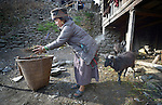 Sher Samu cleans around her home in the Tamang village of Goljung, in the Rasuwa District of Nepal near the country's border with Tibet.