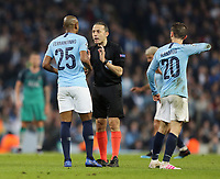 Referee Cuneyt Cakır has words with Manchester City's Fernandinho<br /> <br /> Photographer Rich Linley/CameraSport<br /> <br /> UEFA Champions League - Quarter-finals 2nd Leg - Manchester City v Tottenham Hotspur - Wednesday April 17th 2019 - The Etihad - Manchester<br />  <br /> World Copyright © 2018 CameraSport. All rights reserved. 43 Linden Ave. Countesthorpe. Leicester. England. LE8 5PG - Tel: +44 (0) 116 277 4147 - admin@camerasport.com - www.camerasport.com