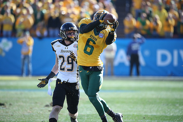FRISCO, TX  JANUARY 4: CJ Smith #6 of the North Dakota State Bison intercepts a pass to Brian Dowling #29 of the Towson Tigers during the Division 1 Football Championship at Toyota Stadium in Frisco on January 4, 2014 in Frisco, NDSU won 35-7. TX.  Photo by Rick Yeatts