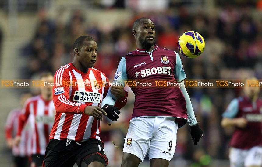 Carlton Cole of West Ham and Titus Bramble of Sunderland - Sunderland vs West Ham United, Barclays Premier League at The Stadium of Light, Sunderland - 12/01/13 - MANDATORY CREDIT: Rob Newell/TGSPHOTO - Self billing applies where appropriate - 0845 094 6026 - contact@tgsphoto.co.uk - NO UNPAID USE.