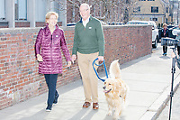 Democratic presidential candidate and Massachusetts senator Elizabeth Warren, husband Bruce Mann, and dog Bailey, walk to a rally with supporters outside Graham & Parks School after the candidate voted in the Massachusetts primary as part of Super Tuesday voting in Cambridge, Massachusetts, on Tue., March 3, 2020. The polling place is just a few blocks from Warren's residence. Polls show Warren and Vermont senator Bernie Sanders in a near tie in the Massachusetts Democratic party primary.