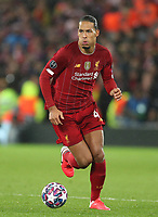 11th March 2020; Anfield, Liverpool, Merseyside, England; UEFA Champions League, Liverpool versus Atletico Madrid;  Virgil van Dijk of Liverpool brings the ball out of defence