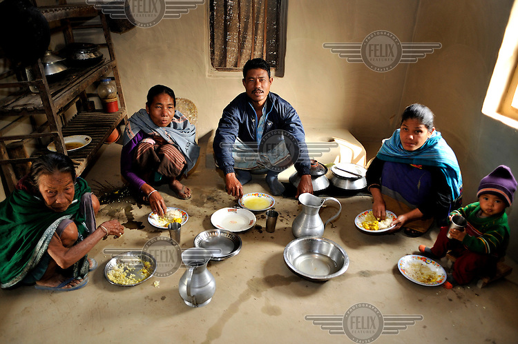 Orola Dalbot and her family having breakfast. Among the Mandi, a remote hill tribe in Bangladesh and India, widows who wish to remarry must choose a man from the same clan as their dead husband. The only single males, however, are often much younger. So the custom evolved that a widow would offer one of her daughters as a second bride to take over her duties -including sex- when the daughter came of age. /Felix Features