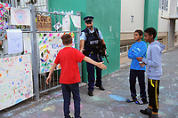 NZ Police youth aid officer Shannon Payne greets kids outside the Wellington Islamic Centre in Wellington, New Zealand on Tuesday, 19 March 2019. Photo: Dave Lintott / lintottphoto.co.nz