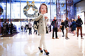 A man with a Hillary Clinton mask walks through the lobby of Trump Tower in New York, New York, USA, 08 December 2016.<br /> Credit: Justin Lane / Pool via CNP