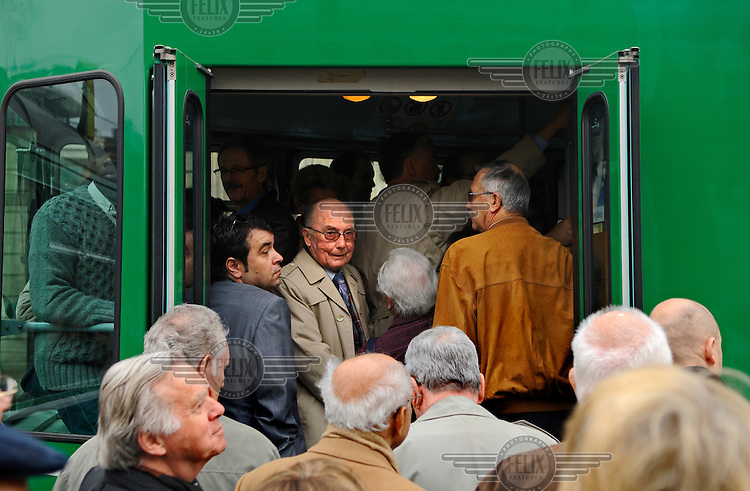 Crush of mostly aged shareholders getting on a tram to go to the annual general meeting of UBS, Switzerland's largest bank. The Swiss banking industry holds an estimated 4,000 billion Swiss Francs (USD 4,240 billion) in assets, more than half of it foreign, including CHF 880 billion in undeclared European assets alone, benefiting from the country's famous banking secrecy laws.