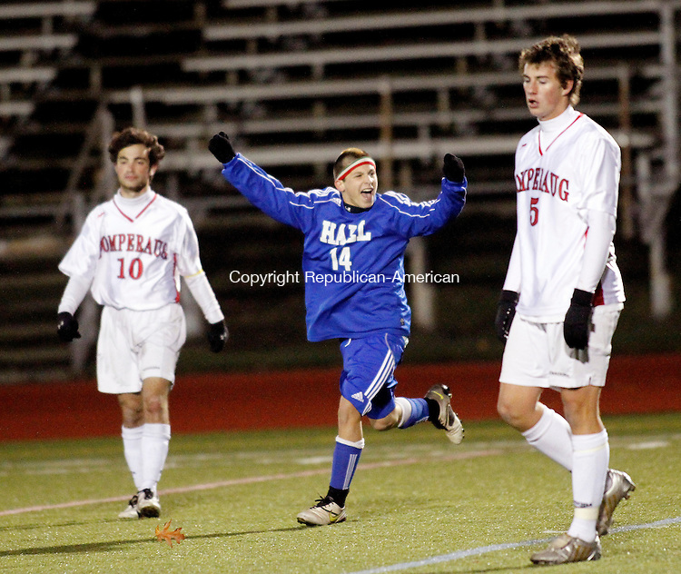 Southbury, CT- 08, November 2010-110810CM11 Conor Scalise (#14) celebrates Hall's  2-1 victory over Pomperaug during the first round of the Class M tournament Monday night in Southbury.  Walking off the field is Pomperaug's Eric Helfer (#10) and Richard Pitman (#5).  Christopher Massa Republican-American