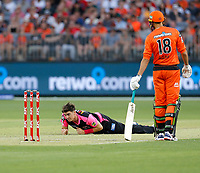26th December 2019; Optus Stadium, Perth, Western Australia, Australia;  Big Bash League Cricket, Perth Scorchers versus Sydney Sixers; Sean Abbott of the Sydney Sixers crawls on the pitch after falling during his delivery stride - Editorial Use