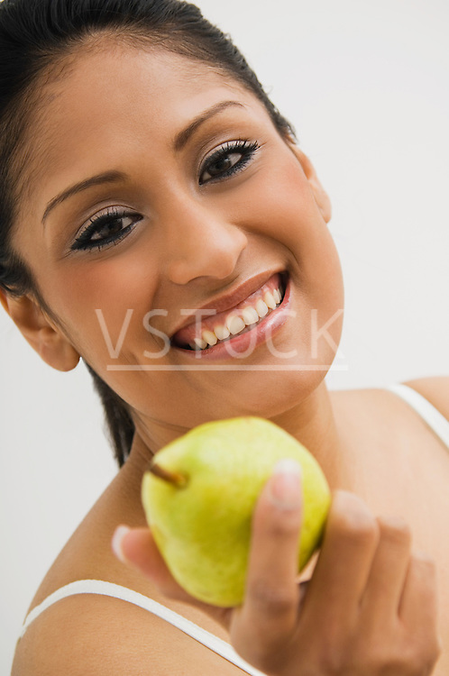 Woman holding pear