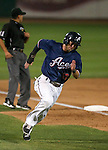 Reno Aces' Mike Freeman rounds third base in a game against the Las Vegas 51s in Reno, Nev., on Saturday, Sept. 6, 2014. The Reno Aces defeated the Las Vegas 51s, 7-3, to win the Pacific Conference Championship Series. <br /> Photo by Cathleen Allison