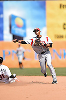 Carolina Mudcats shortstop Erik Gonzalez (10) attempts to turn a double play as third baseman Manny Machado (31) slides in during a game against the Frederick Keys on April 26, 2014 at Harry Grove Stadium in Frederick, Maryland.  Carolina defeated Frederick 4-2.  (Mike Janes/Four Seam Images)