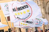 Roma 07-09-2013 Piazza Montecitorio. Manifestazione dei militanti del Movimento 5 Stelle mentre 12 deputati hanno occupato il tetto di Palazzo Montecitorio per protestare contro quello che secondo loro e' un tentativo di stravolgere la costituzione con il DDL sulle riforme. Espongono uno striscione con scritto: la costituzione e' di tutti.<br /> 12 Deputates of Mvement 5 Stars climbed the Lower Chamber's roof to protest against , they says, the attempt of the Parliament to change the constitution with the reforms.<br /> Photo Samantha Zucchi Insidefoto
