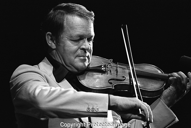 """Svend Asmussen, Sept. 20, 1975, Monterey Jazz Festival. jazz violinist from Denmark, known as """"The Fiddling Viking"""". Asmussen started violin lessons at age 7. At age 16 he first heard recordings by jazz violin great Joe Venuti and began to emulate his style. He started working professionally as a violinist, vibraphonist, and singer at age 17, leaving his formal training behind for good. Asmussen also worked with Benny Goodman, Lionel Hampton, and Duke Ellington. Asmussen was invited by Ellington to play on the Jazz Violin Session recording in 1963 with Stéphane Grappelli and Ray Nance."""