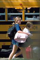Teens age 13 leaving on a bus from the Minnesota State Fair.  St Paul Minnesota USA
