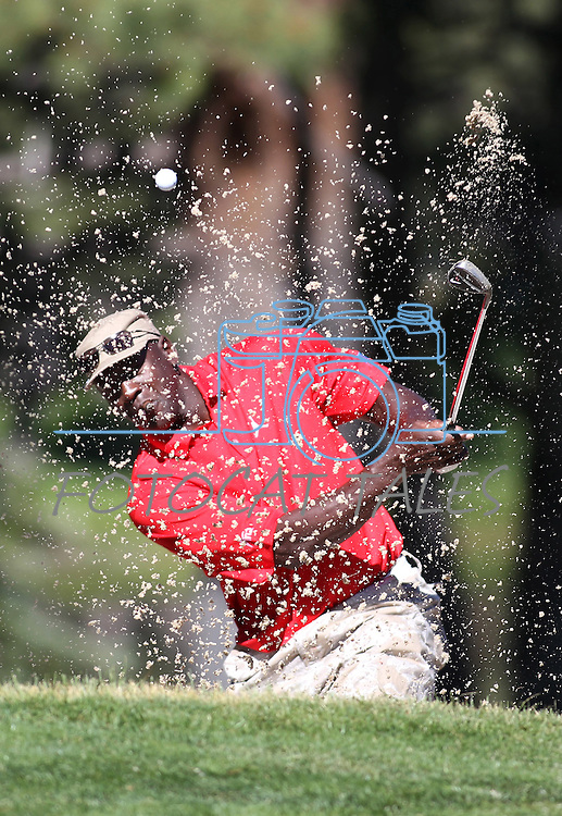 Michael Jordan hits out of the sand during a practice round at the 22nd American Century Celebrity Golf Championship at Edgewood Tahoe Golf Course in Stateline, Nev., on Wednesday, July 13, 2011. .Photo by Cathleen Allison