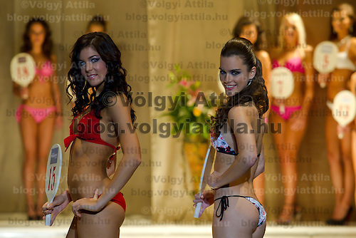 Alexandra Horvath (left) and Timea Gelencser (right) attends the Miss Hungary 2010 beauty contest held in Budapest, Hungary on November 29, 2010. ATTILA VOLGYI