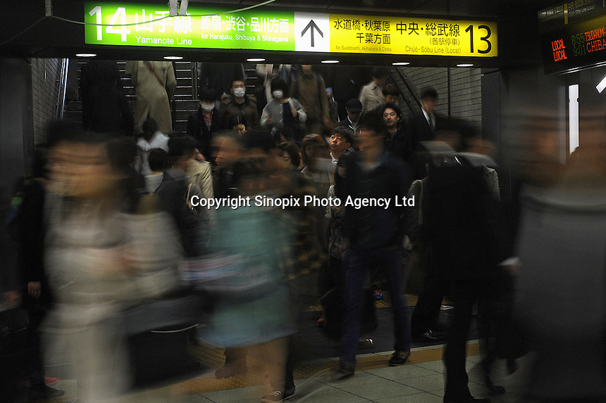 Businessmen rush from a platform into an underground passag in Shinjuku Station, Tokyo, Japan.  With up to 4 million passengers passing through it every day, Shinjuku station, Tokyo, Japan, is the busiest train station in the world. The station was used by an average of 3.64 million people per day.  That&rsquo;s 1.3 billion a year.  Or a fifth of humanity. Shinjuku has 36 platforms, and connects 12 different subway and railway lines.  Morning rush hour is pandemonium with all trains 200% full. <br /> <br /> Photo by Richard jones / sinopix