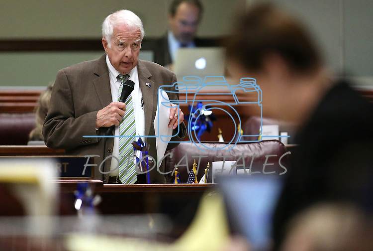 Nevada Assemblyman Lynn Stewart, R-Henderson, works on the Assembly floor at the Legislative Building in Carson City, Nev., on Monday, April 6, 2015. <br /> Photo by Cathleen Allison