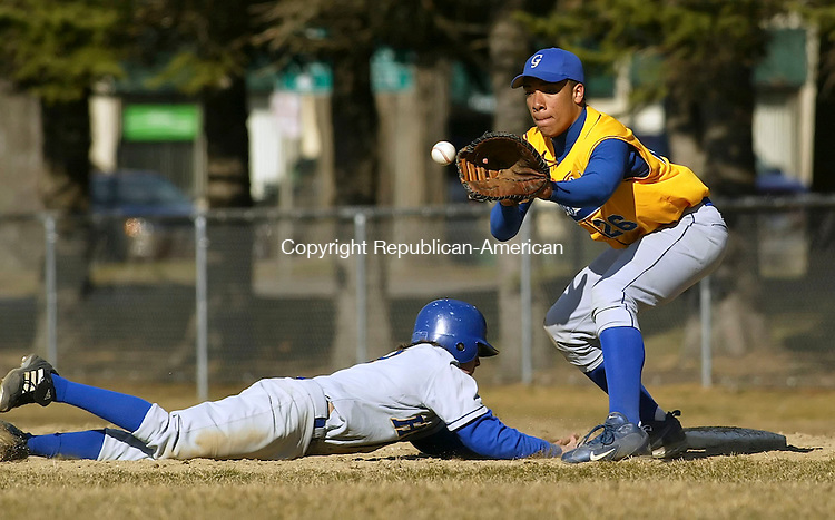 WINSTED, CT 4/9/07- 040907BZ12- Gilbert's Andrew Pimentel (26) waits for the ball at first as Housatonic's Peter O'Reilly (9) gets safely back during Monday's game.<br /> Jamison C. Bazinet Republican-American